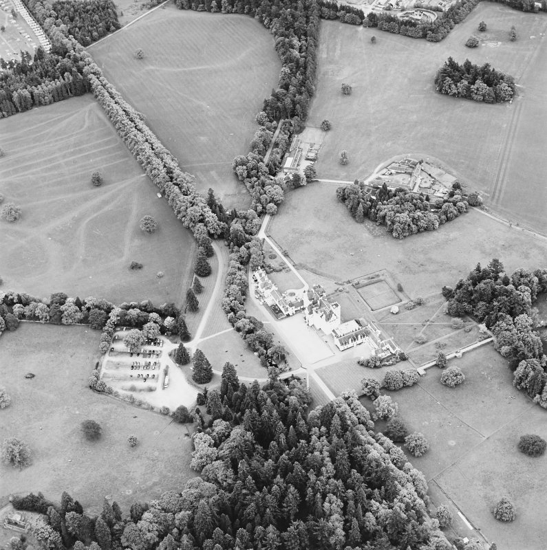 Oblique aerial view of Blair Castle centred on the country house and garden, taken from the NNW.