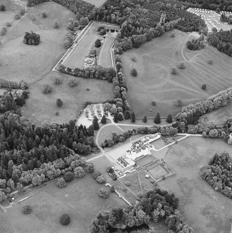 Oblique aerial view of Blair Castle centred on the country house, garden and walled garden, taken from the WSW.