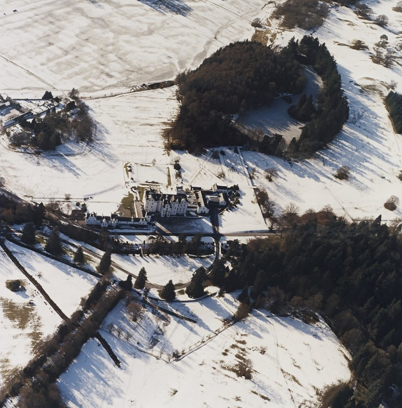 Oblique aerial view centred on the country house and garden, with the dairy adjacent, taken from the NE.