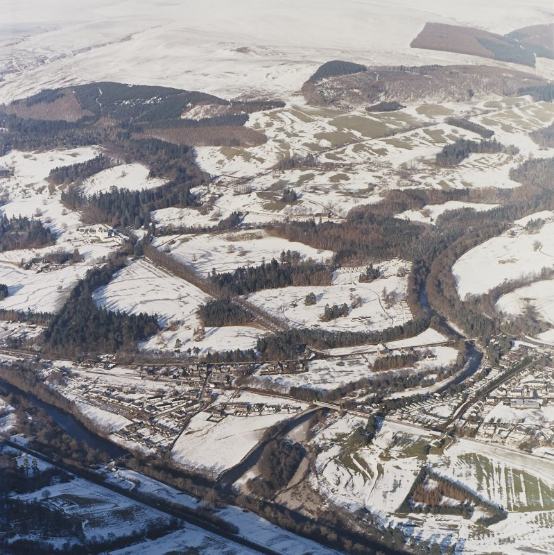 General oblique aerial view of the village with the country house adjacent, taken from the SSE.