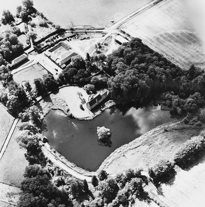 Ecclesiamagirdle, oblique aerial view, taken from the N, centred on the remains of the chapel and the Laird's House and dovecot.