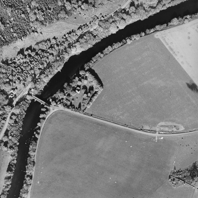 Oblique aerial view centred on the remains of the tower-house with road bridge adjacent, taken from the WSW.
