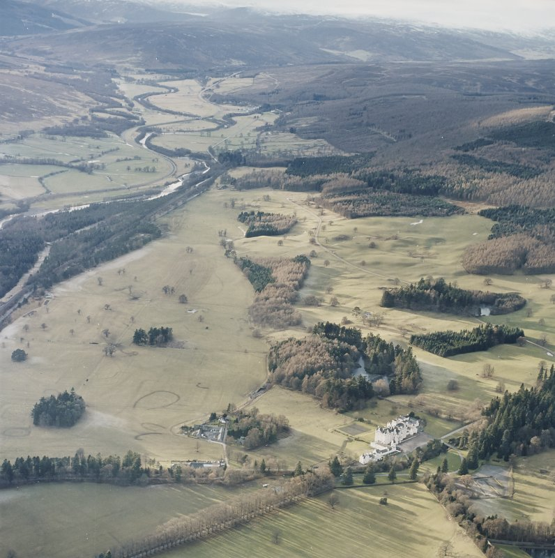 General oblique aerial view of the glen with the country house and dairy adjacent, taken from the ENE.