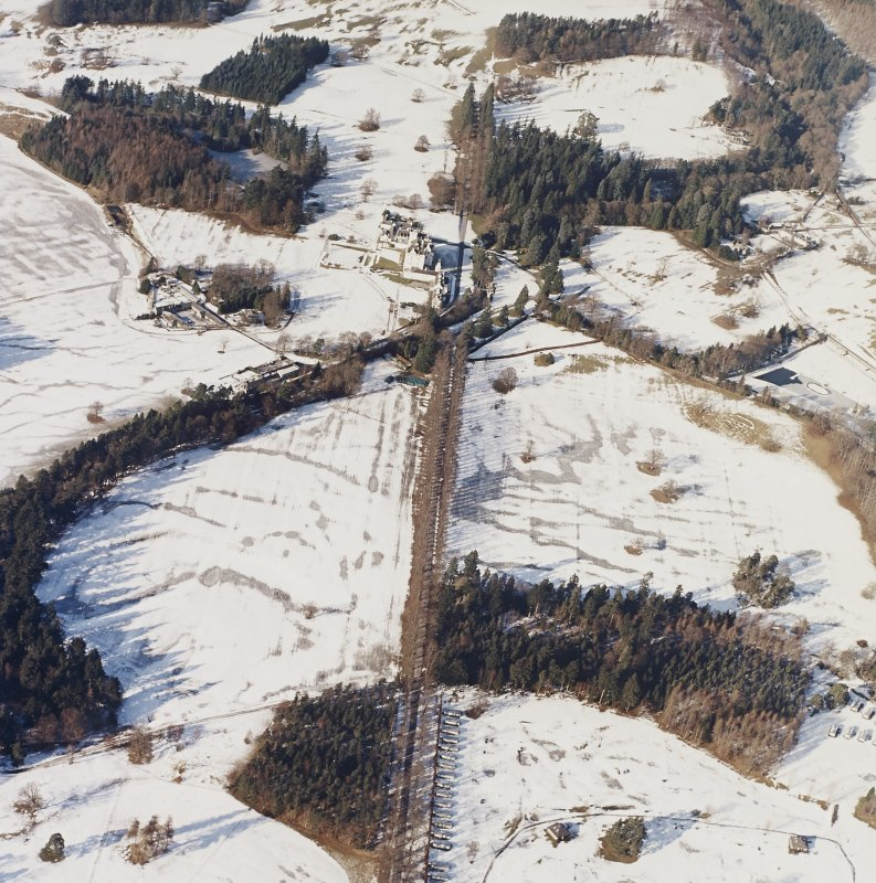 General oblique aerial view centred on the country house and garden, with the dairy adjacent, taken from the .