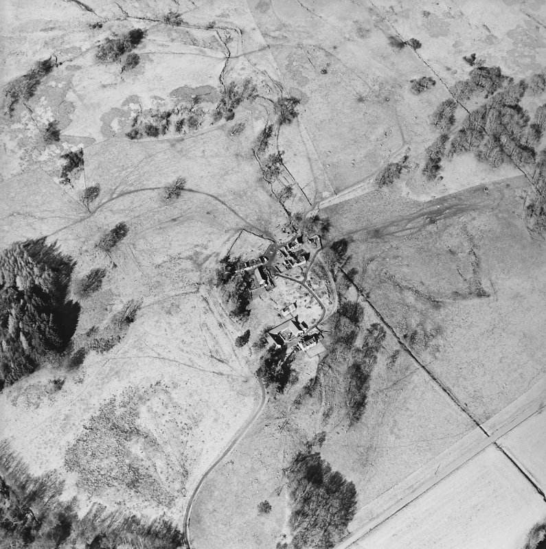 Oblique aerial view centred on the farmsteads and remains of the township, taken from the SSE.