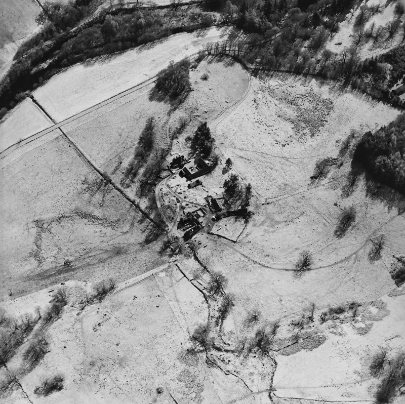 Oblique aerial view centred on the farmsteads and remains of the township, taken from the N.