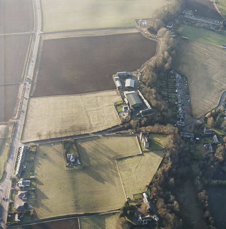 Oblique aerial view centred on the remains of the formal garden with the tower-house adjacent, taken from the E.