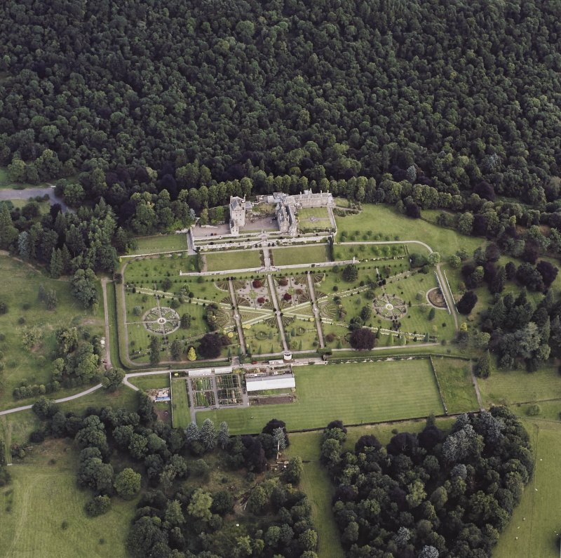 Oblique aerial view centred on Drummond Castle and gardens, taken from the S