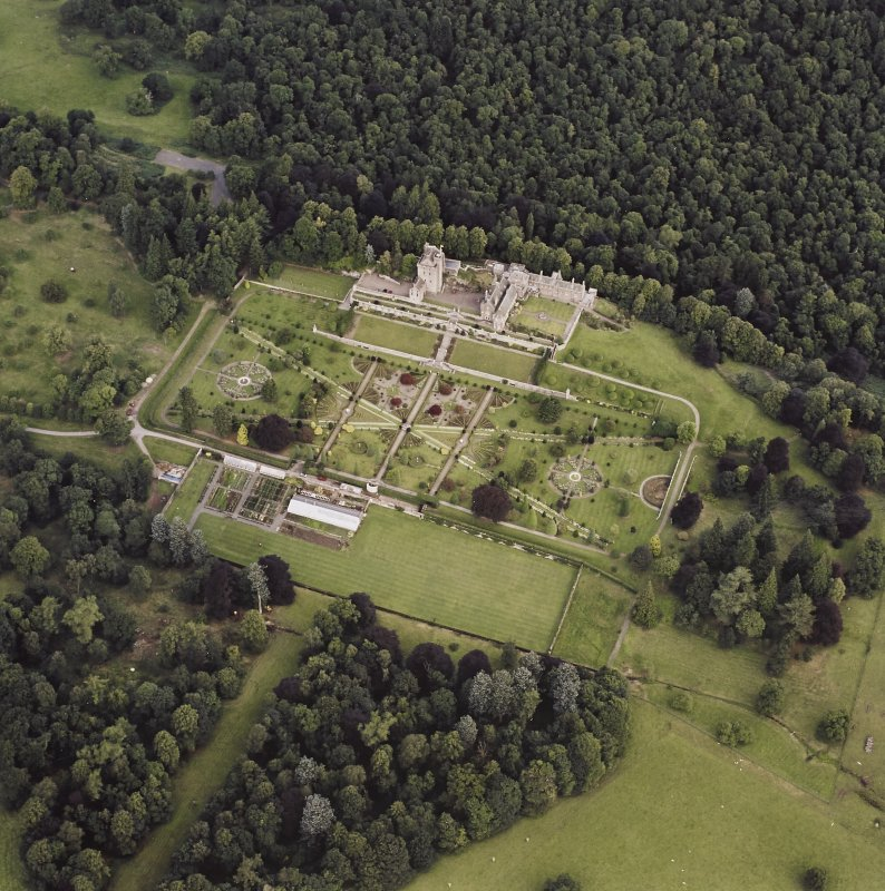 Oblique aerial view centred on Drummond Castle and gardens, taken from the SSE