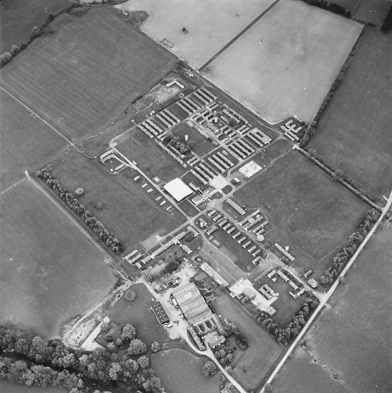 Oblique aerial view centred on the military camp with the bunker, observation post and remains of the church and graveyard adjacent, taken from the S.