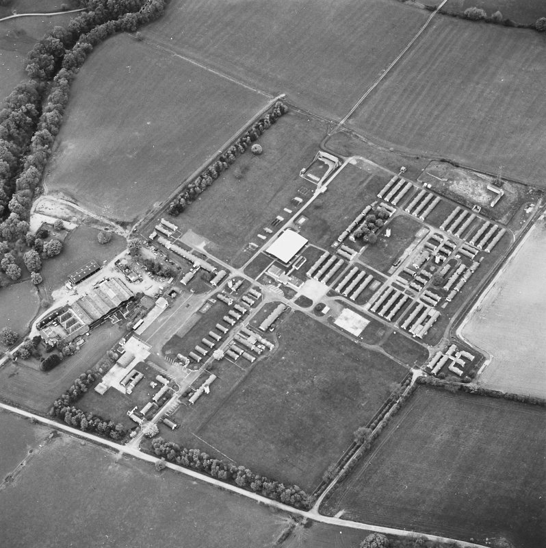 Oblique aerial view centred on the military camp with the bunker, observation post and remains of the church and graveyard adjacent, taken from the ESE.