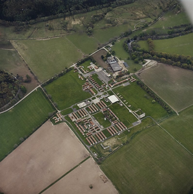 Oblique aerial view centred on the military camp with the bunker, observation post and remains of the church and graveyard adjacent, taken from the N.