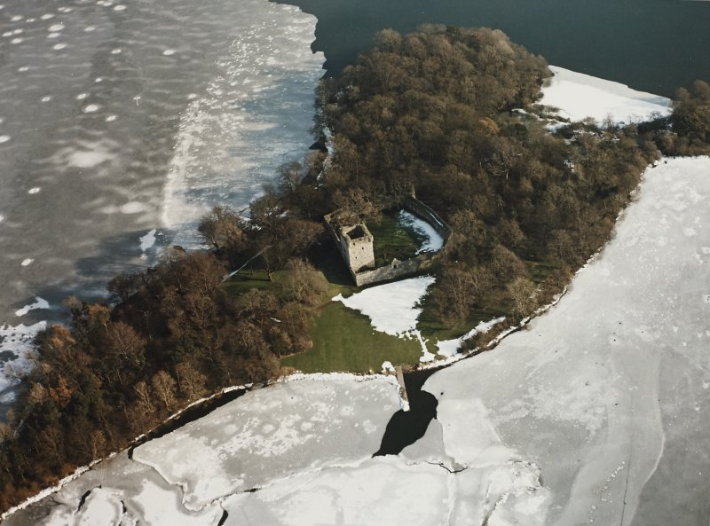 Oblique aerial view of Lochleven Castle in the snow.