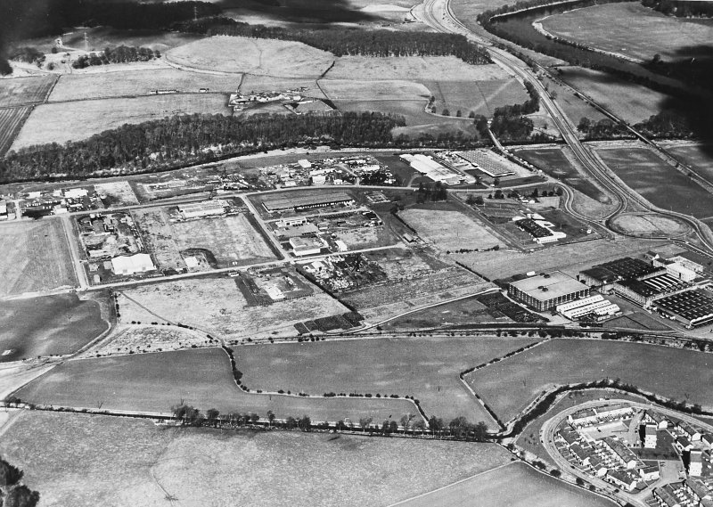 Oblique aerial view centred on the construction of the industrial estate with the road bridges, viaduct and the site of the Roman fort adjacent, taken from the SSW.