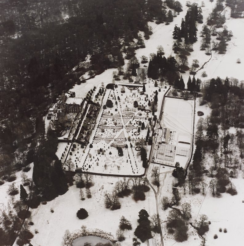 Drummond Castle. General aerial view of castle, garden etc under snow.