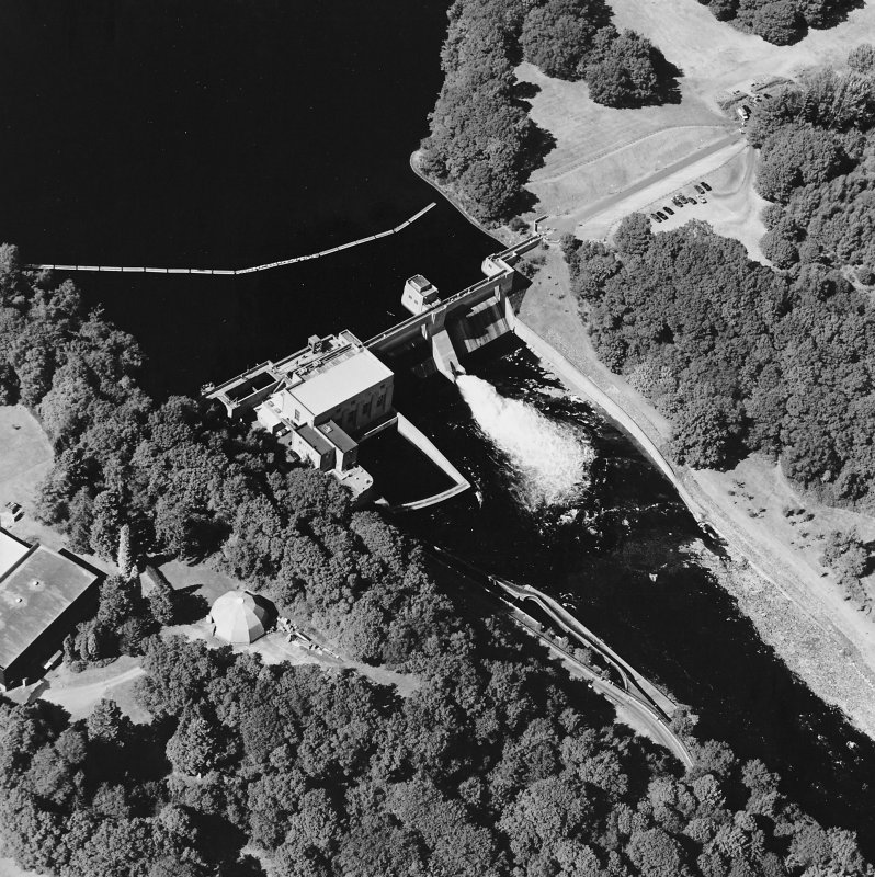 Pitlochry, Loch Faskally, oblique aerial view, taken from the SE, centred on the dam, electricity generating station and fish ladders.