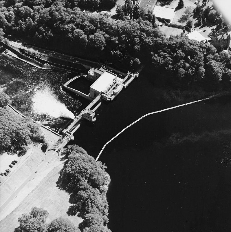 Pitlochry, Loch Faskally, oblique aerial view, taken from the N, centred on the dam, electricity generating station and fish ladders.