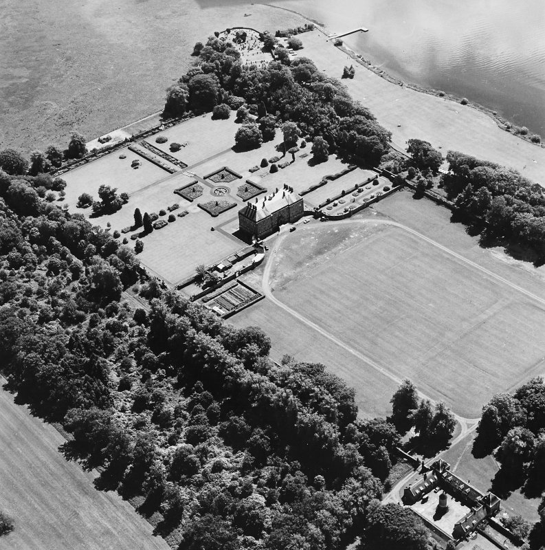 Oblique aerial view of Kinross House country house with garden, gate, stables and church and burial ground visible, taken from the NNW.