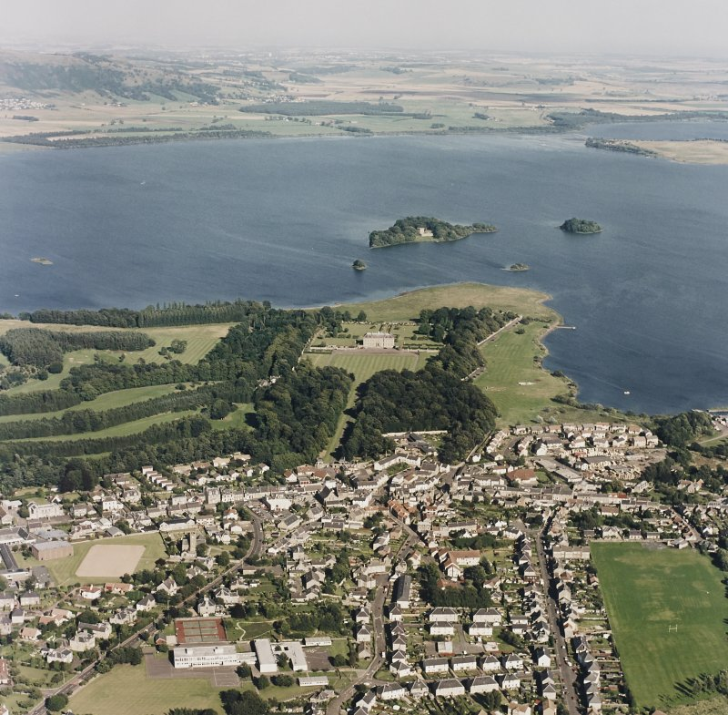 Oblique aerial view of Kinross House centred on the country house with Lochleven Castle in the background, taken from the WNW.