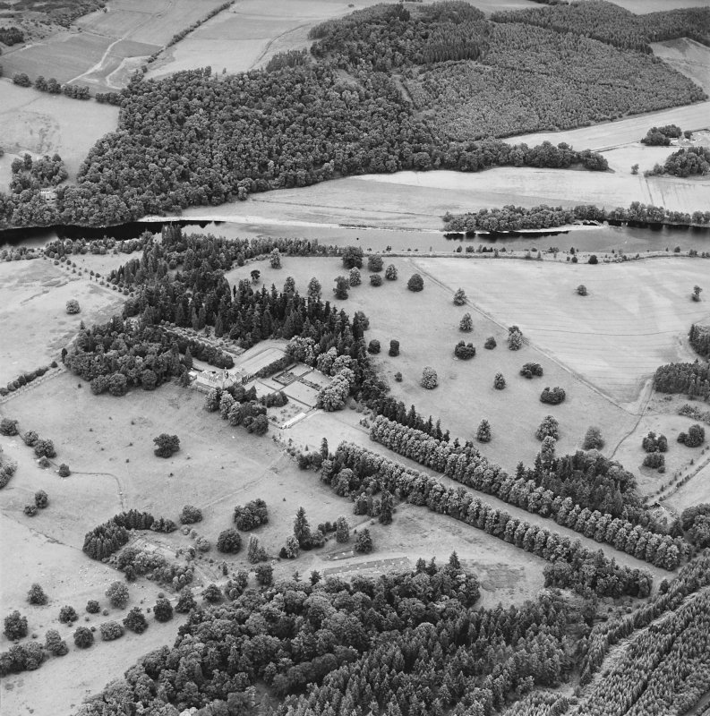 Oblique aerial view of Murthly Castle centred on the castle and walled garden, taken from the SW.