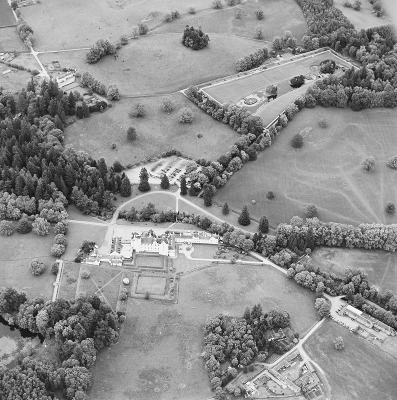 Oblique aerial view of Blair Castle centred on the country house, garden and walled garden, with the remains of a church adjacent, taken from the SW.
