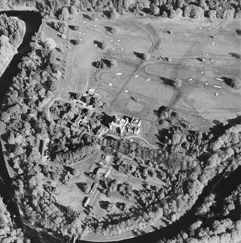 Oblique aerial view centred on the country house with golf club house and remains of military camp adjacent, taken from the WNW.