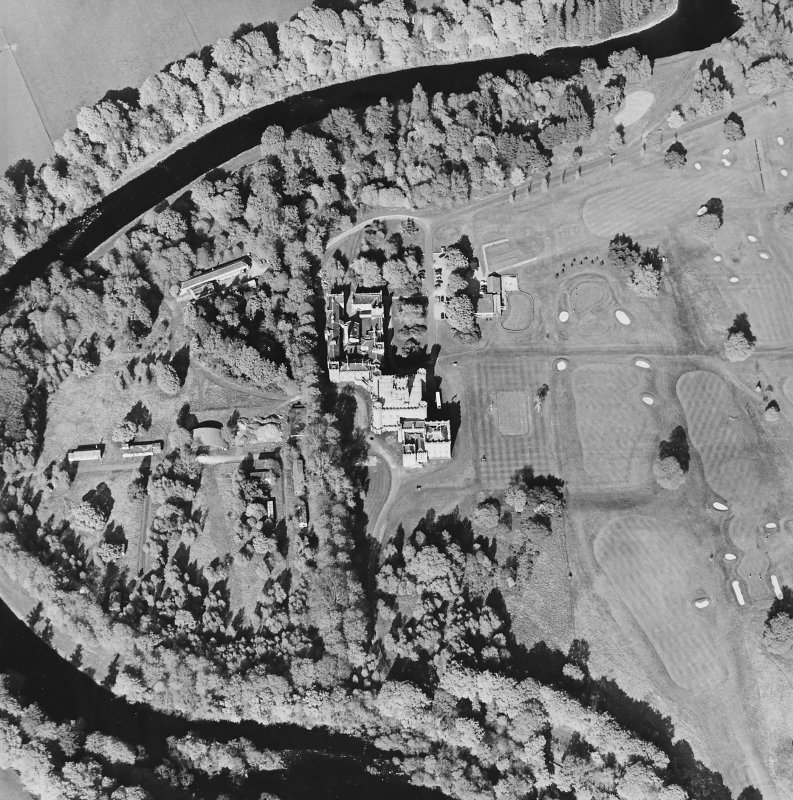 Oblique aerial view centred on the country house with golf club house and remains of military camp adjacent, taken from the WSW.