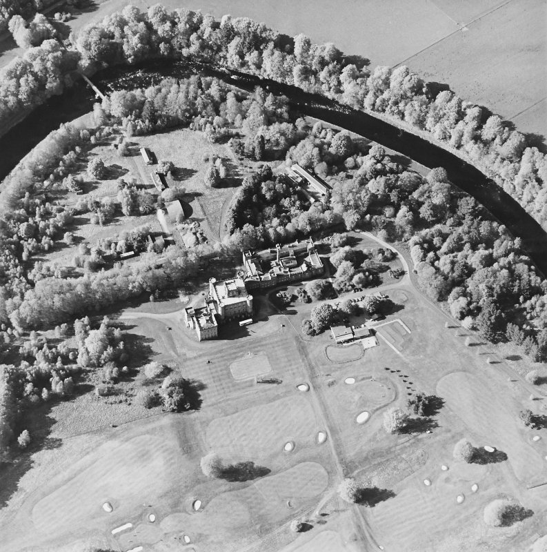 Oblique aerial view centred on the country house with golf club house and remains of military camp adjacent, taken from the SSE.