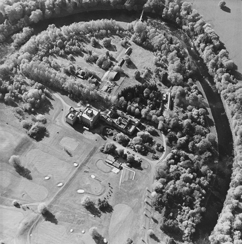 Oblique aerial view centred on the country house with golf club house and remains of military camp adjacent, taken from the ESE.