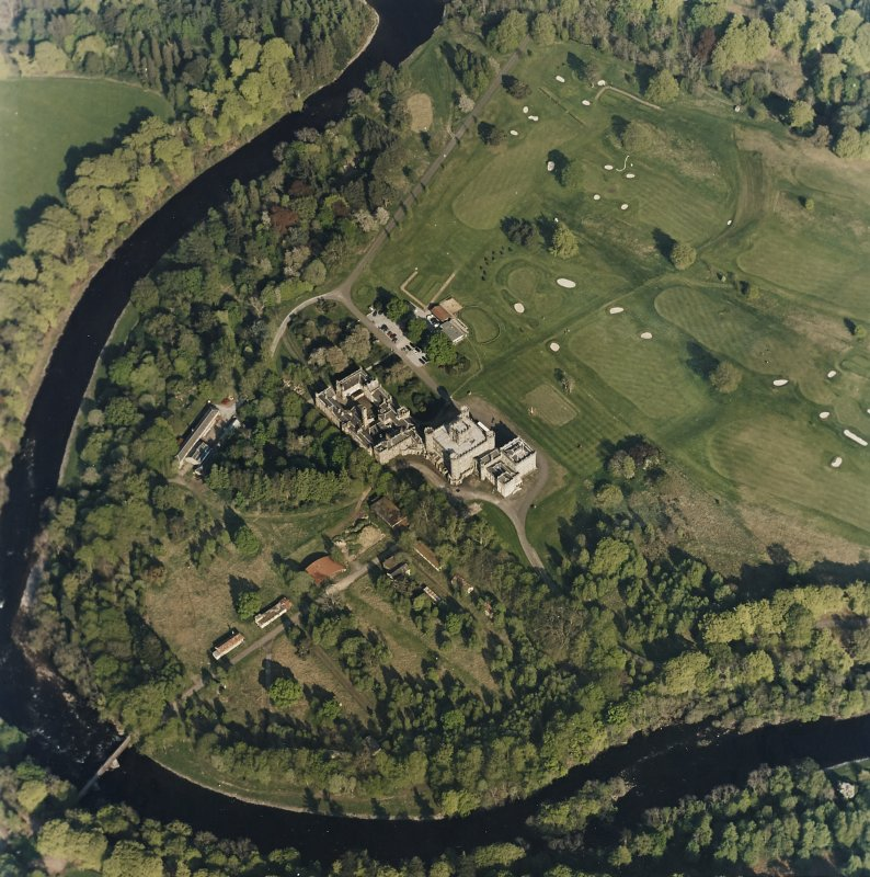 Oblique aerial view centred on the country house with golf club house and remains of military camp adjacent, taken from the W.