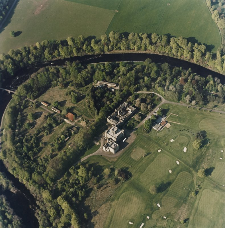 Oblique aerial view centred on the country house with golf club house and remains of military camp adjacent, taken from the SSW.