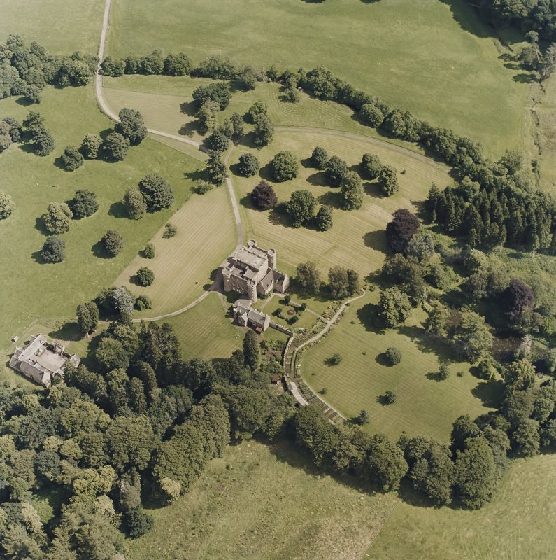 Oblique aerial view centred on the country house and tower-house, taken from the W.