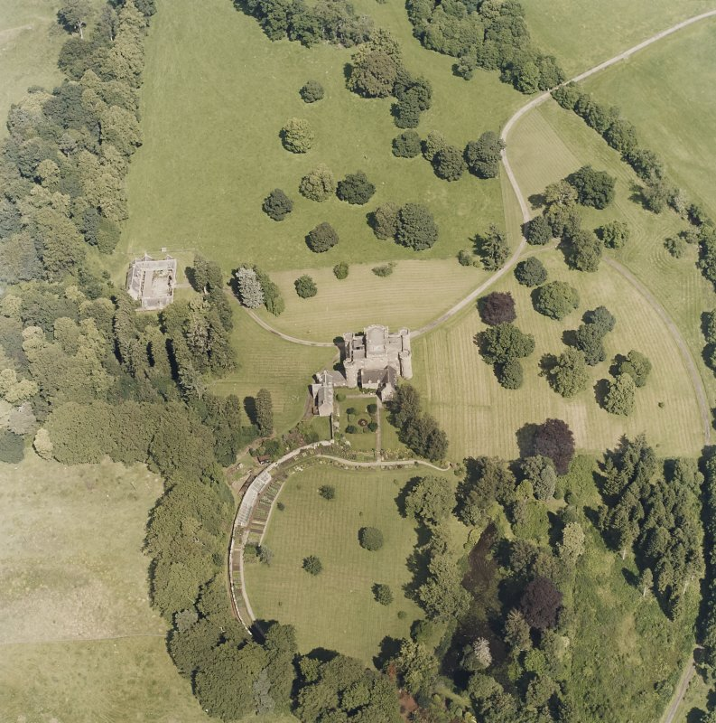 Oblique aerial view centred on the country house and tower-house, taken from the SW.