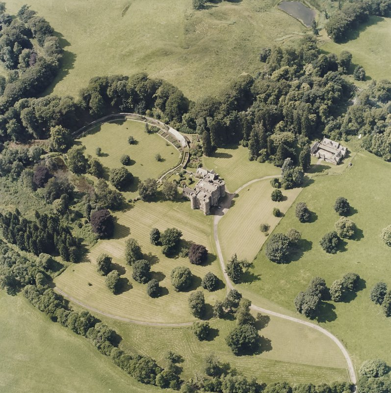 Oblique aerial view centred on the country house and tower-house, taken from the E.