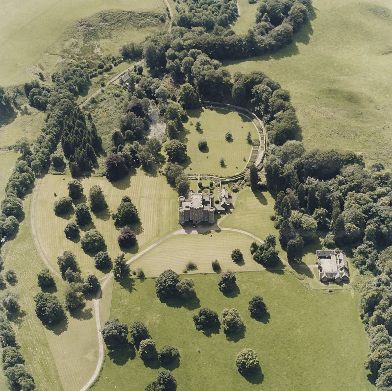 Oblique aerial view centred on the country house and tower-house, taken from the NE.