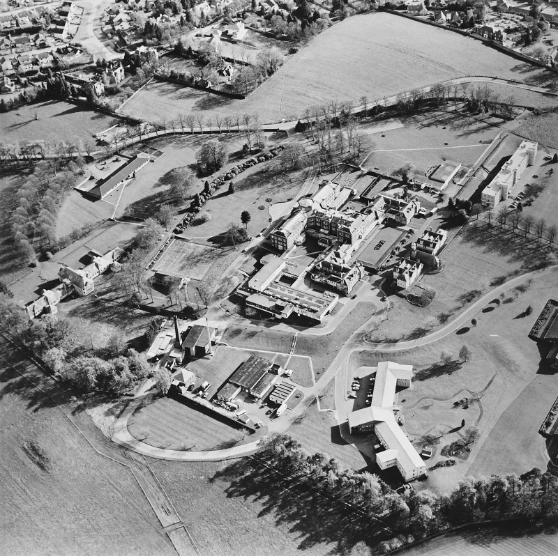 Oblique aerial view centred on the hospital and chapel with the remains of the rig adjacent, taken from the NNE.