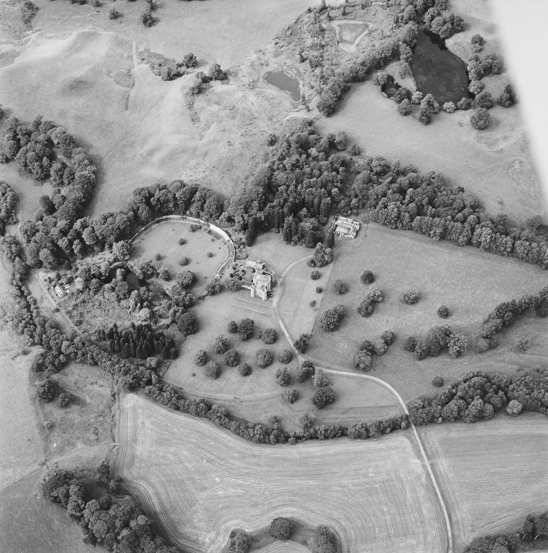Oblique aerial view centred on the country house and tower-house and the walled garden, taken from the SE.
