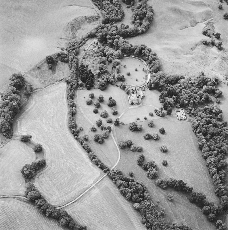 Oblique aerial view centred on the country house and tower-house and the walled garden, taken from the NE.