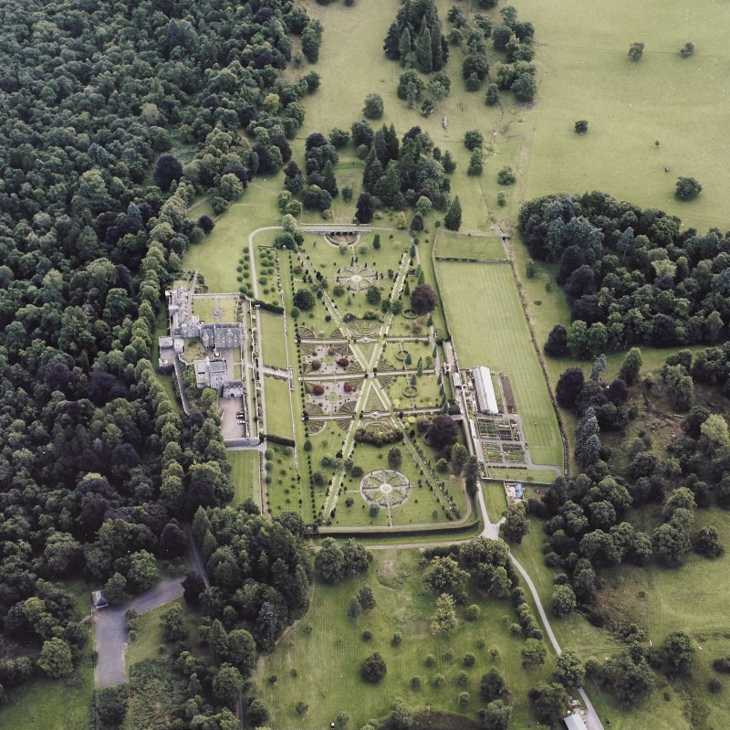 Oblique aerial view centred on Drummond Castle and gardens, taken from the W