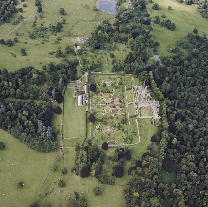 Oblique aerial view centred on Drummond Castle and gardens, taken from the E