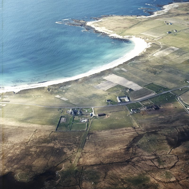 General oblique aerial view looking towards the bay of Culla across the farmhouse, the farmstead, the farmsteading and the burial enclosures adjacent, taken from the SE