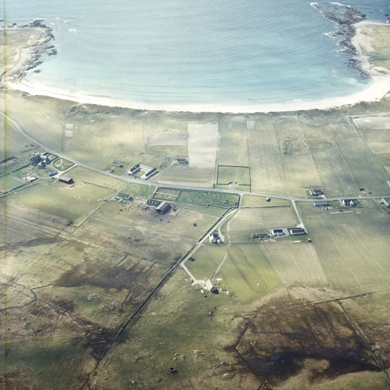 General oblique aerial view looking towards the bay of Culla across the farmhouse, the farmstead, the farmsteading and the burial enclosures adjacent, taken from the E