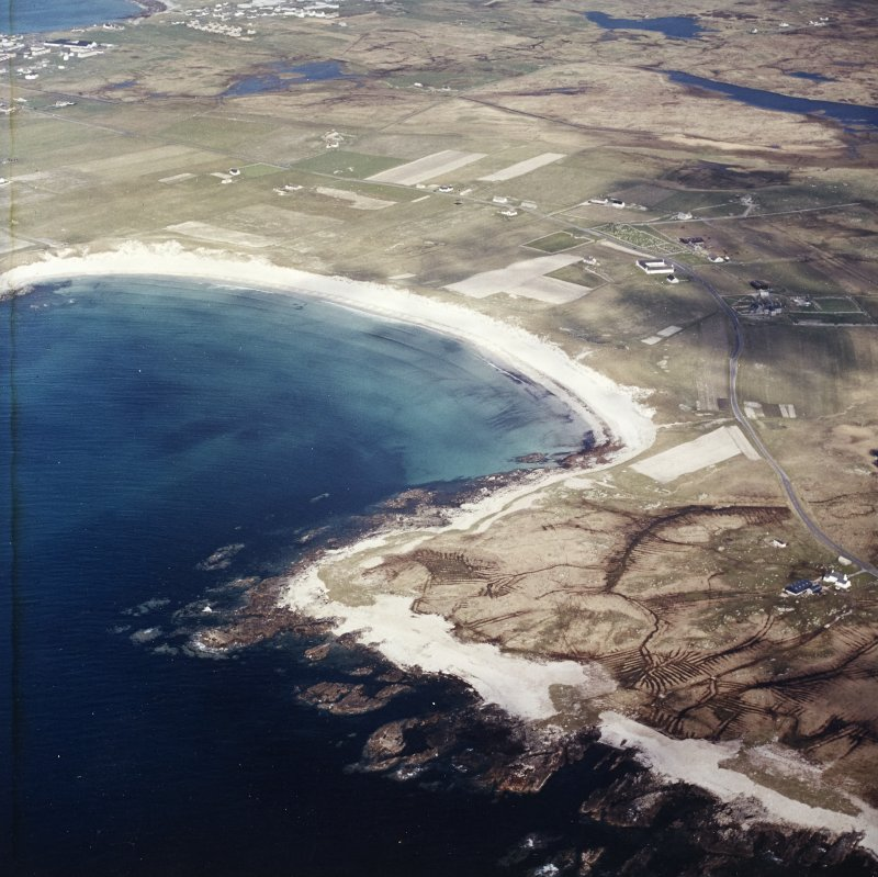 General oblique aerial view looking across the bay of Culla towards the township of Balvanich, taken from the SW.