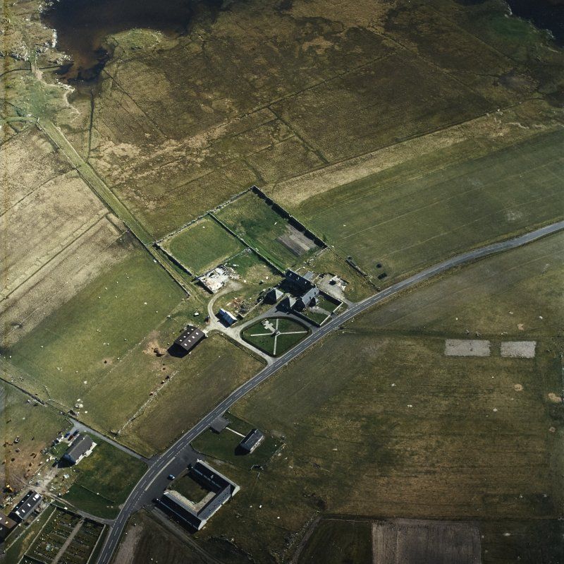 Oblique aerial view centred on the farmhouse, with the farmstead and the farmsteading adjacent, taken from the NNE