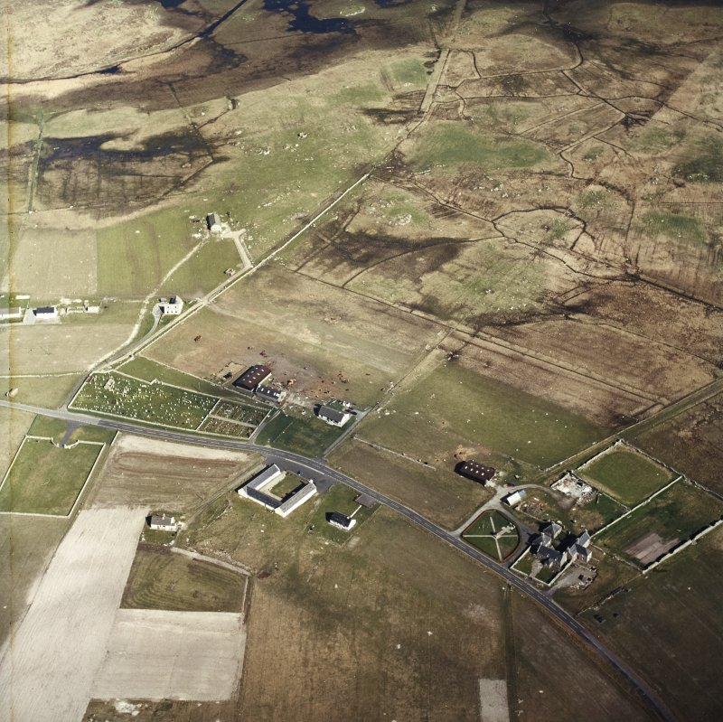 Oblique aerial view centred on the farmsteads and the farmsteadings, with the farmhouse and the burial enclosures adjacent, taken from the WNW