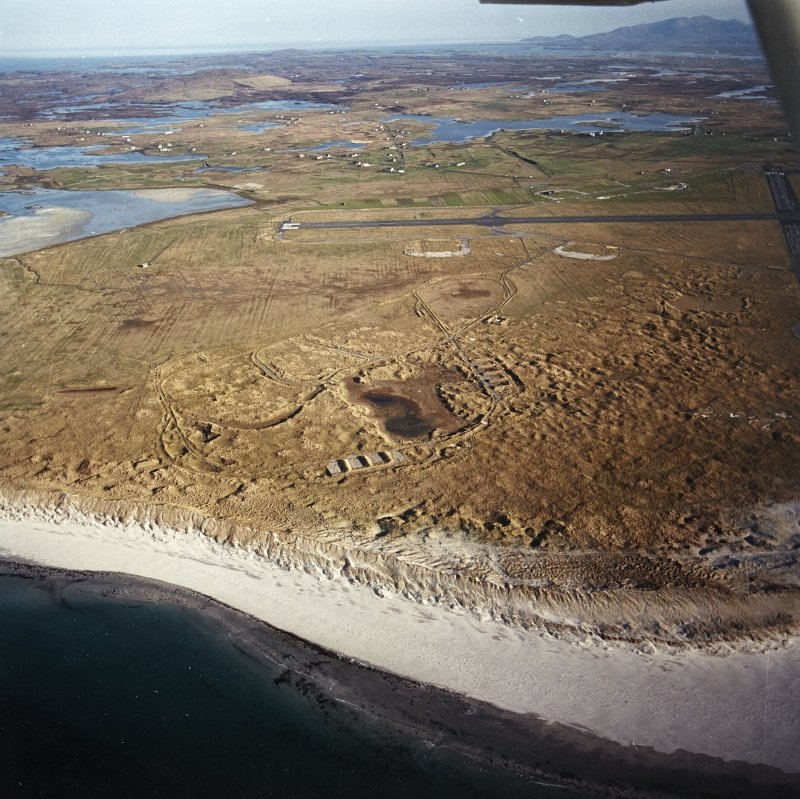 General oblique aerial view looking over Benbecula airport and Gramasdail towards The Little Minch beyond, taken from the NNW.