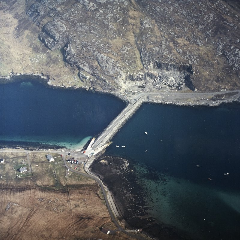 Oblique aerial view centred on the causeway and slipways with the quarry adjacent, taken from the S.
