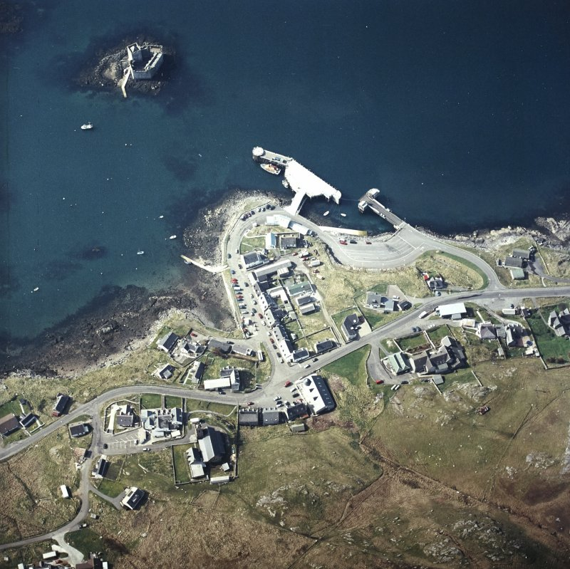 Oblique aerial view centred on the town with the tower-house, church and pier adjacent, taken from the NE.
