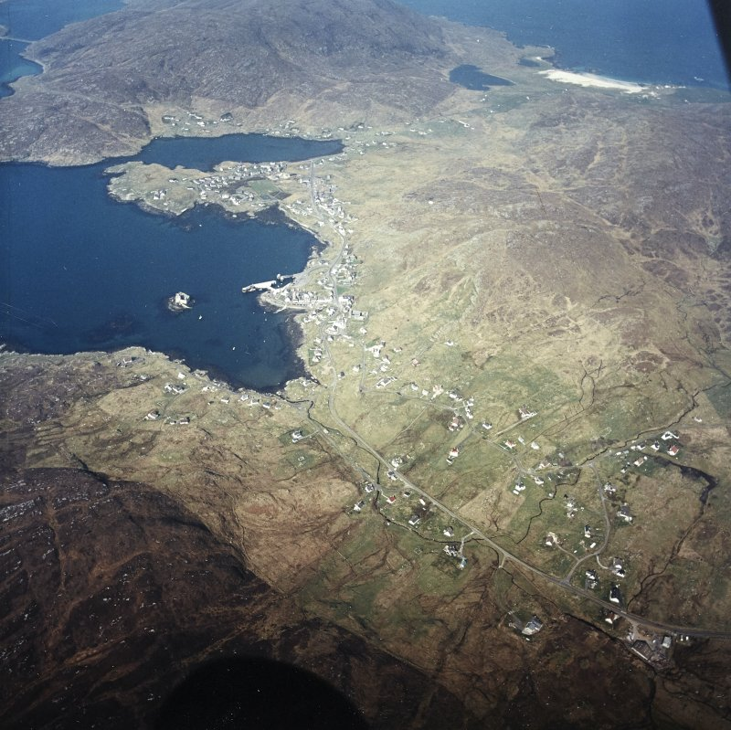 General oblique aerial view of Castlebay, the tower-house and pier, taken from the E.
