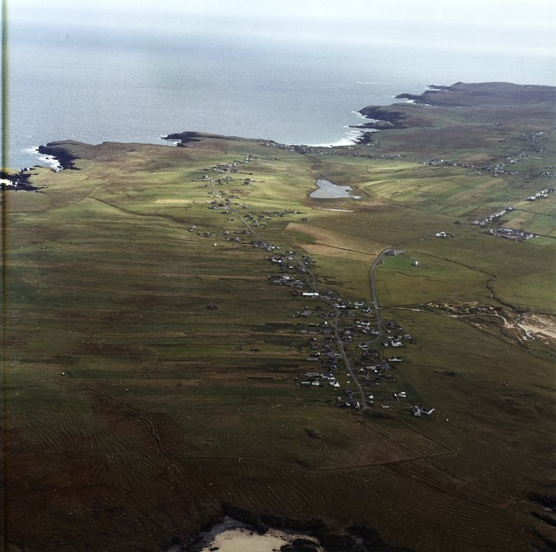 Oblique aerial view centred on the townships and remains of lazy beds, taken from the NW.